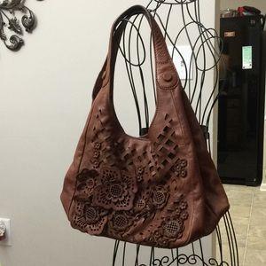 Brighton handcrafted leather floral cutout handbag